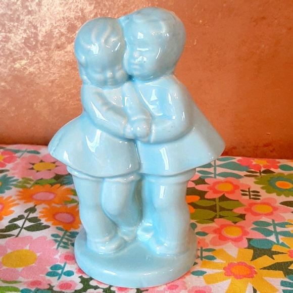 Vintage pottery boy and girl planter blue